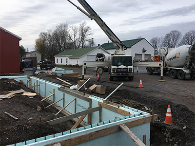 Concrete footers being poured