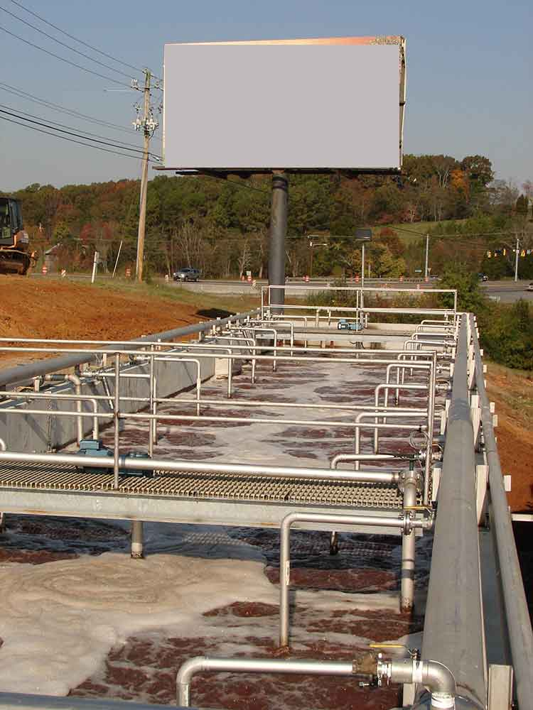100,000 gals per day activated sludge wastewater system designed by Aries Chemical